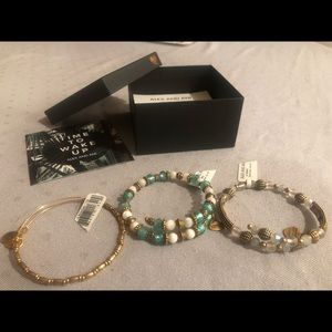3 Alex and Ani bracelets with tags and box